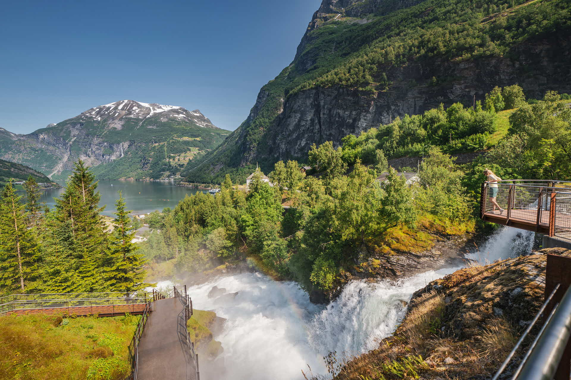 A person standing on the Waterfall trail in Geiranger