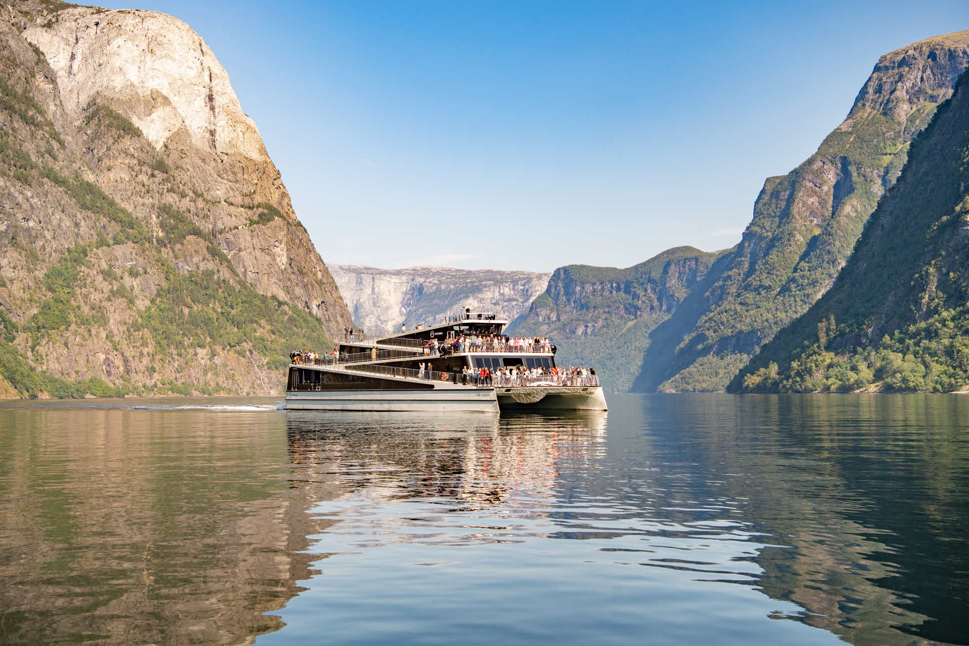 The electric boat Future of the Fjords sails silently on the Nærøyfjord