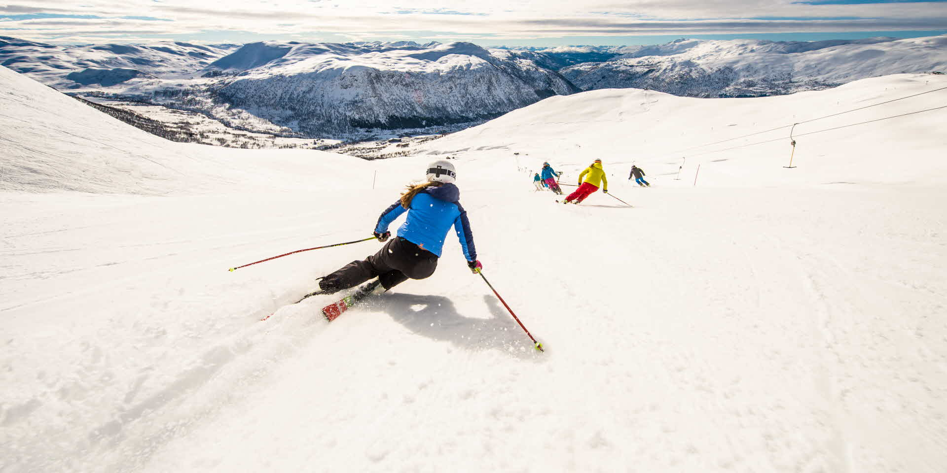 Girls skiing the slopes in Myrkdalen Mountain Resort. Views to winter landscape.