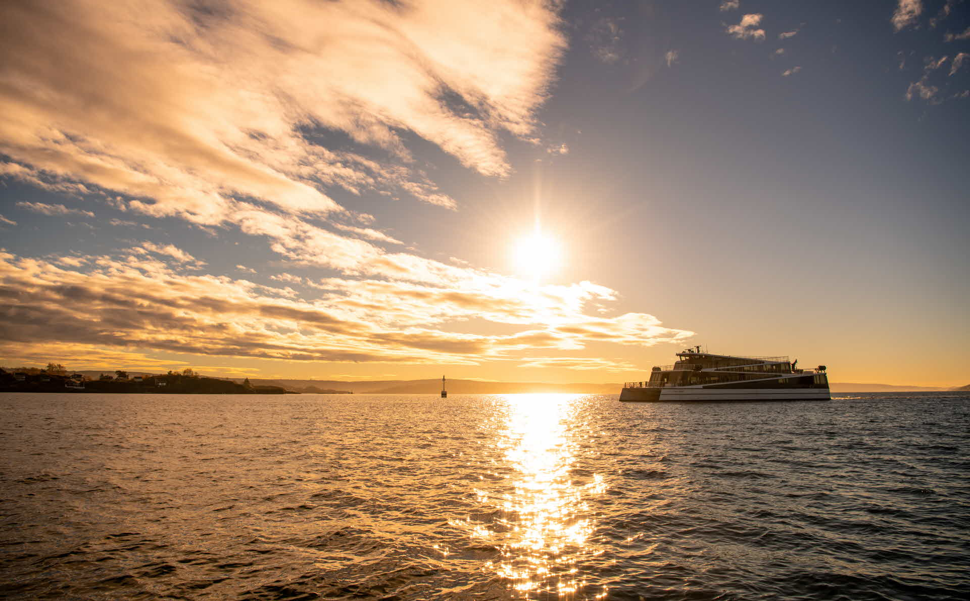 An electric boat on Oslofjord in the sunset