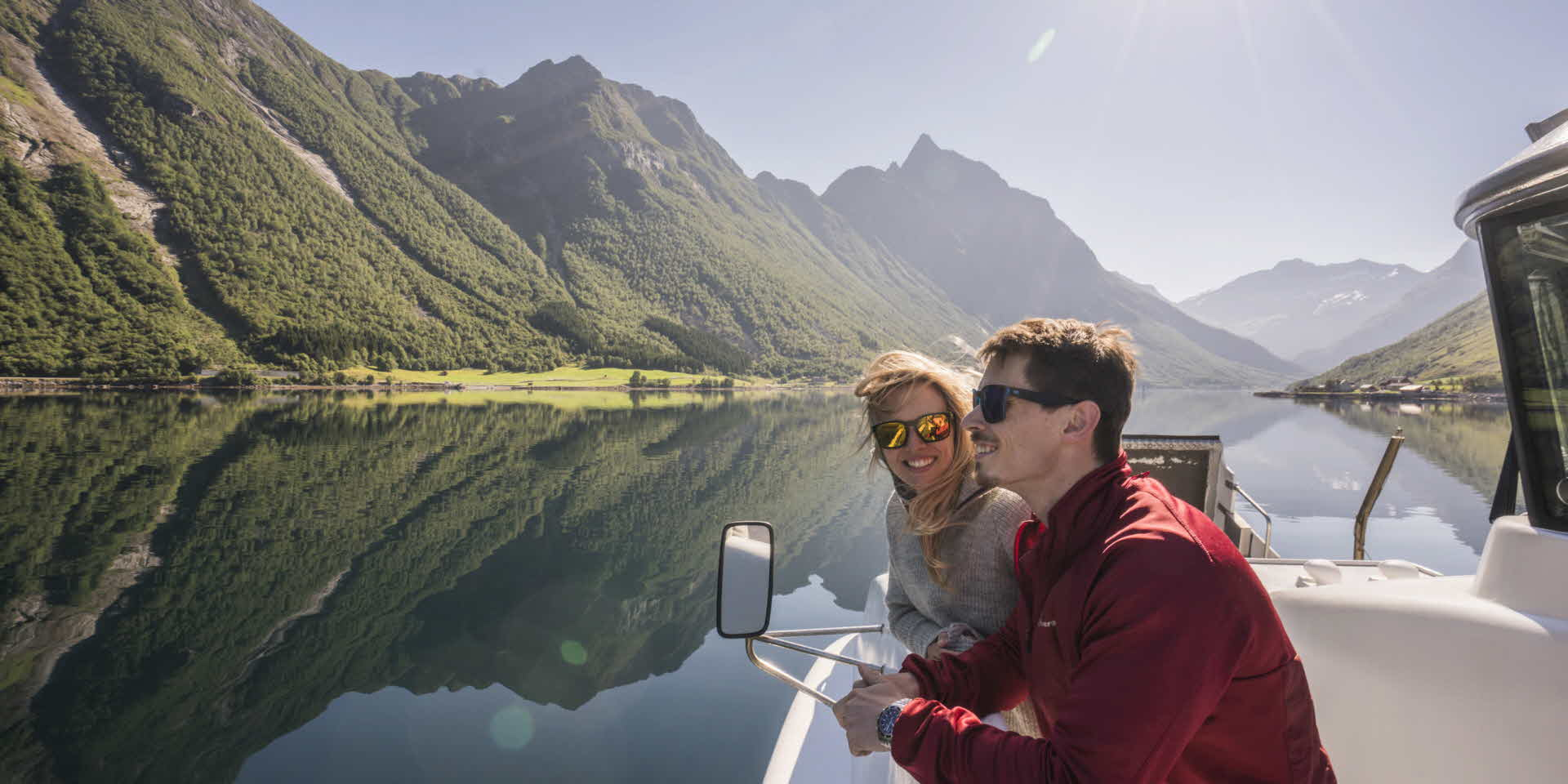 Young couple onbord Fjord Viking on beautiful Hjørundfjord