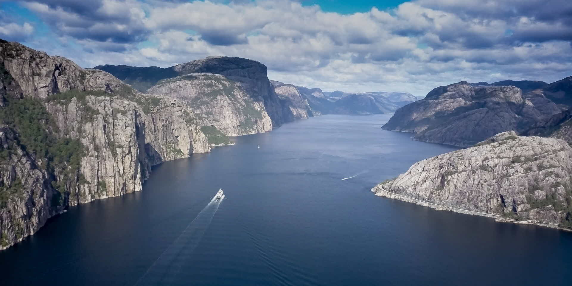 Fjord Cruise Lysefjord tourist ferry sail through the dramatic rocky landscape seen from birds eye perspective